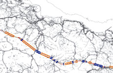 Reducing High-Speed Rail Costs by Combined Double-Single Tracks